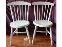 Pair of vintage kitchen chairs in a farmhouse style & they seem fairly old.