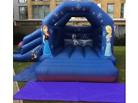 Month old bluetooth frozen bouncy slide castle with blower and matts