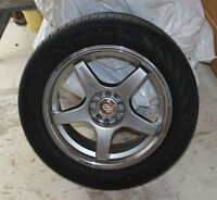 4 Tires and rims very very low mileage on them