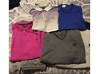 3 jumpers and 2 polo shirts.