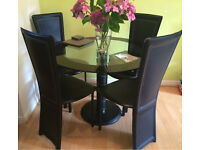 Dining table and 4 faux leather chairs for sale!