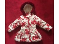 Marks and Spencer's Girls red and cream winter coat. Size 2-3