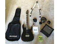 Ibanez black guitar and micro cube amp bundle