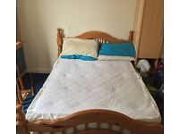 Pine double bed no mattress. Excellent condition.