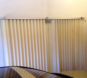 Beige vertical track window blinds