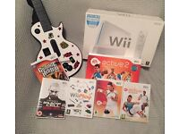 Nintendo Wii package with guitar hero & EA sports pack