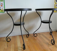 two IKEA black round metal tables