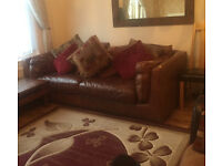 Real leather sofa including pillows-average condition