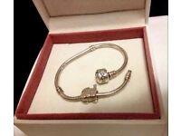Genuine Pandora Bracelet (17cm) and Pram Charm