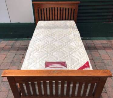 Excellent wooden frame single bed with pillow top mattress