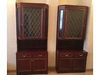 Pair of mahogany glass display cabinets with draws