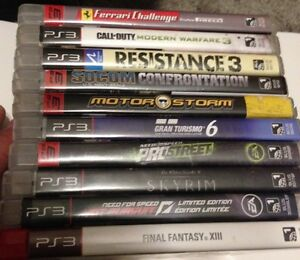 PS3 with games and controller  Prince George British Columbia image 2