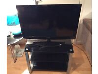 """32"""" Samsung Tv and media stand, very good condition"""