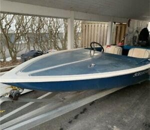 J-craft ski boat, outboard motor and trailer.