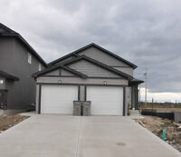 NEW.!!  2 bedrooms lower level suite with garage in Riverstone..