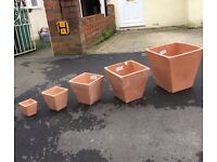 Set of terracotta garden plant pots