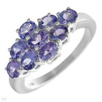 NEW RING WITH 9 PCS. OF TANZANITE CRAFTED IN STERLING SILVER