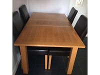 Extending solid oak dining table.