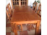 Large pine dining table and 4 chairs