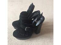 2 pairs of woman's black heels