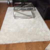 Cream Rug  91 inches length by 65 inches width