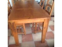 Pine table and four chairs In good condition