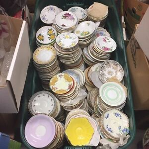 Large bin of vintage saucers