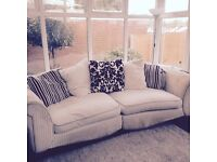 Cream and black sofa and pouffe DFS