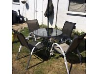 Lovely cute little four seater table and chairs with parasol! Never been used!!