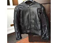 RST black series leathers.
