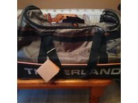 Timberland Rolling Luggage. Brand New with Tags. Bag.