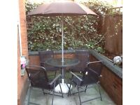 Garden table , chairs and umbrella