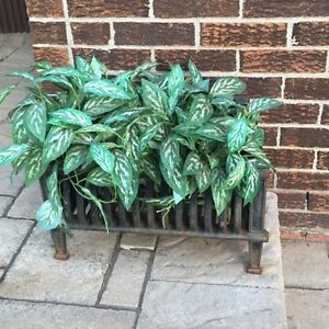 Cast iron fireplace log holder with faux plant