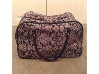 Purple travel cabin size suitcase