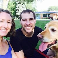 Couple with golden retriever looking for rental