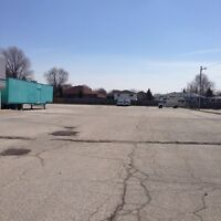 1.5 Acres Of Paved Parking  Spaces Available!