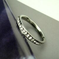 STAINLESS STEEL & INLAID PAVE CZs ETERNITY BAND - Size 6