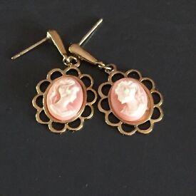 Gold tone cameo earrings