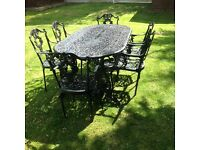 CAST ALUMINIUM GARDEN TABLE AND 6 CARVER CHAIRS VERY HEAVY