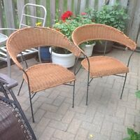 TWO OUTDOOR WICKER LOOK PATIO CHAIRS