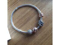 Pandora rose gold bracelet with charms