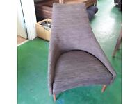 armless chair with footstool