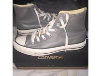 Grey leather high top converse