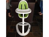 Free standing mama and papa high chair.