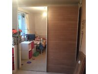 Mirrored wardrobe with sliding doors