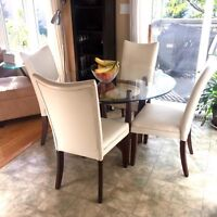 New condition glass table and 4 chairs