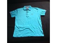 brand new lacoste blue polo L