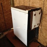 White enamel wood-burning stove ideal for cabin