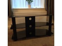 Black glass Tv Stand, in mint condition