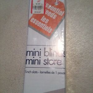 New mini blind 42 in. Wide x 45 inches long